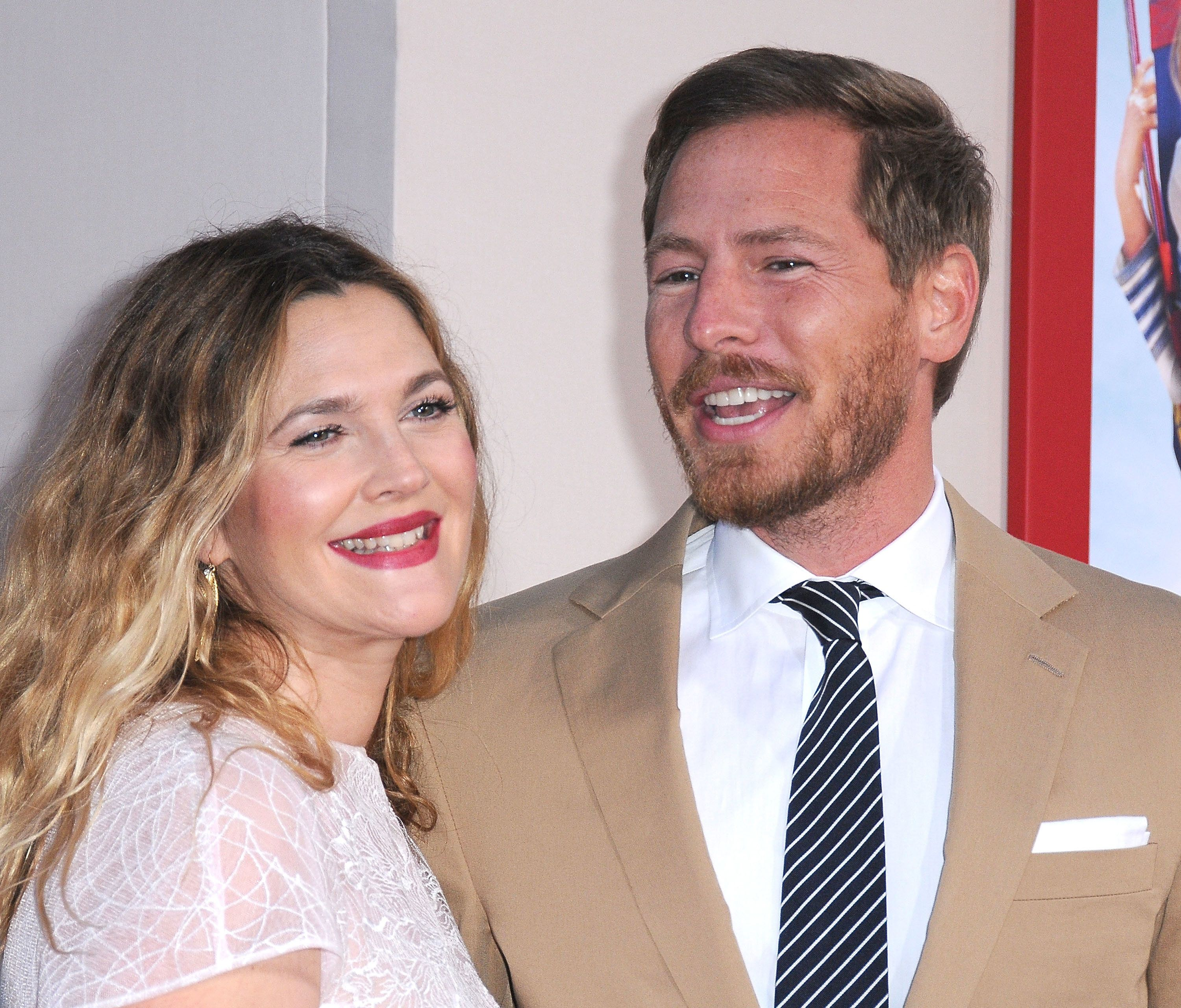 HOLLYWOOD, CA - MAY 21:  Actress Drew Barrymore (L) and husband Will Kopelman arrive at the Los Angeles Premiere 'Blended' on May 21, 2014 at TCL Chinese Theatre in Hollywood, California.  (Photo by Barry King/FilmMagic)
