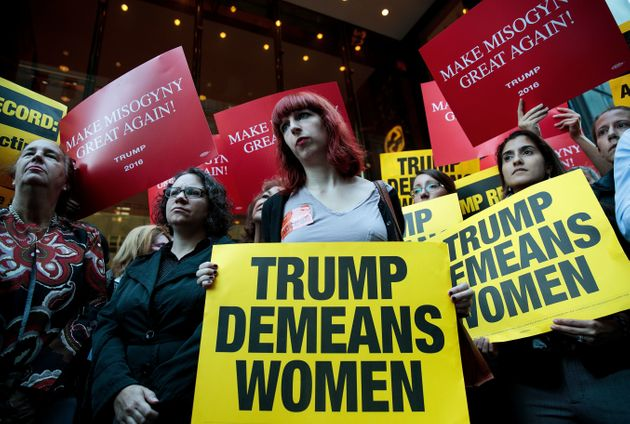 Activists rally during a protest against Trump on Monday. Multiple women have come forward recently alleging...