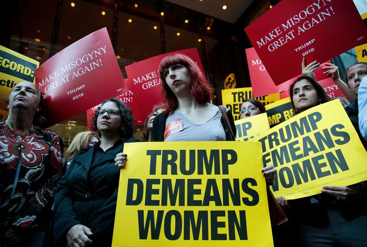 Activists rally during a protest against Trump on Monday. Multiple women have come forward recently alleging sexual misconduc