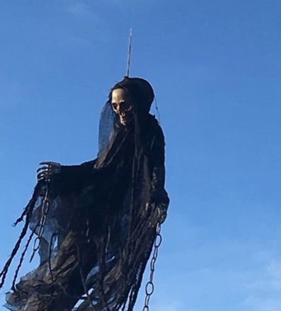 The spooky prank involved a fake skeleton ghost with chains and a raggedly black cloak.