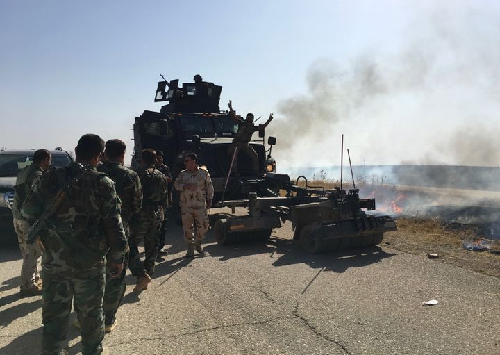 Iraqi soldiers man a minesweeper vehicle in Hasan al Sham, northern Iraq, on Tuesday.