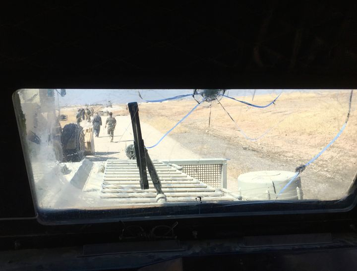 "The view from inside of a Peshmerga armored, mine-resistant ""Badger"" vehicle."