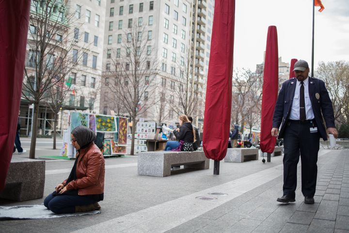 A woman prays nearNew York City's Metropolitan Museum of Art.