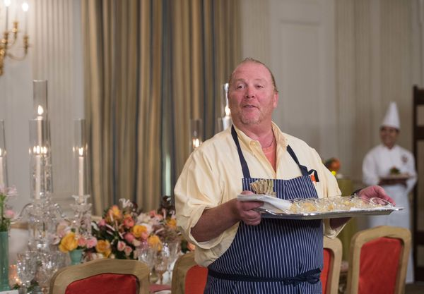 Chef Mario Batali speaks to the press at the White House in Washington, DC, on October 17, 2016 during a preview of the state