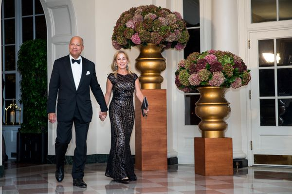 US Secretary of Homeland Security Jeh Johnson and Susan DiMarco.(Photo by Zach Gibson/AFP/Getty Images)