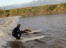 Surfer's Daring Proposal Makes A Seriously Romantic Splash