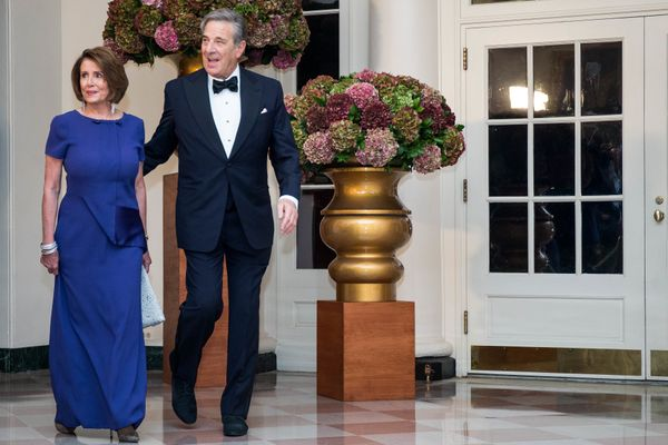 House Democratic Leader Nancy Pelosi and Paul Pelosi. (Photo by Zach Gibson/AFP/Getty Images)