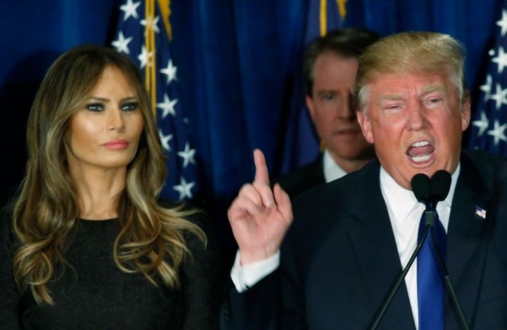 Republican U.S. presidential candidate Donald Trump gestures during his victory speech as his wife Melania, looks on at his 2
