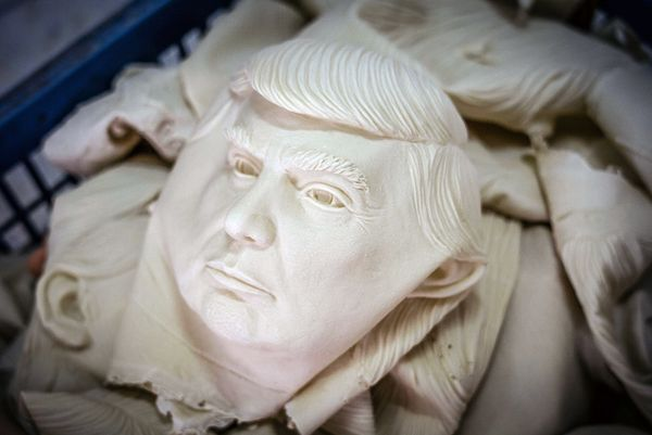 Masks of Donald Trump are seen in a basket.