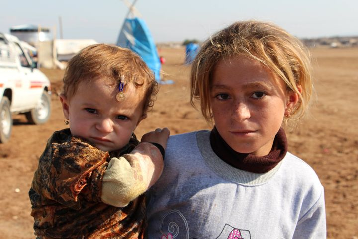 Iraqi Yezidi refugees, who fled from ISIS in the Sinjar district of Mosul, at the Newroz refugee camp in Derik