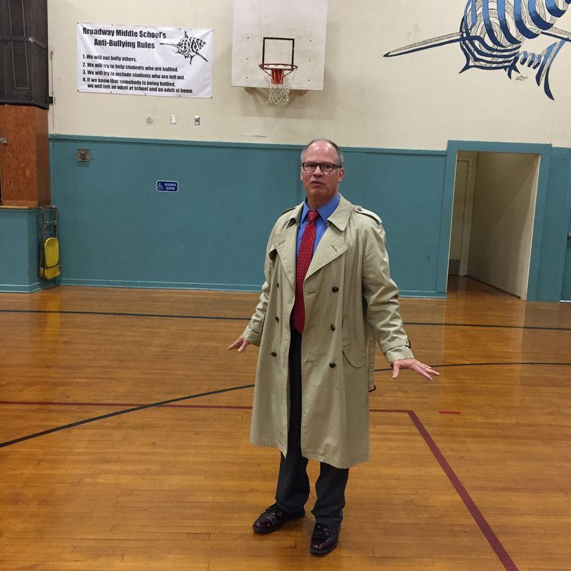 Seaside Superintendent-emeritus Doug Dougherty leads a tour of Seaside's schools. In the high-school gym, metal roof tie-down