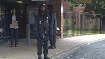 A member of the New Black Panther Party stands outside a polling place in Philadelphia in 2008