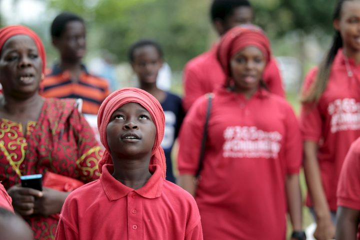 A Bring Back Our Girls (BBOG) campaigner looks on during a protest procession marking the 500th day since the abduction of gi