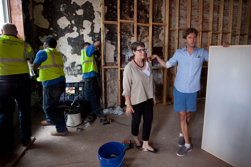 "Architect Barbara Nelson and artist Adam Frelin stand in one of the ""Breathing Lights"" sites."