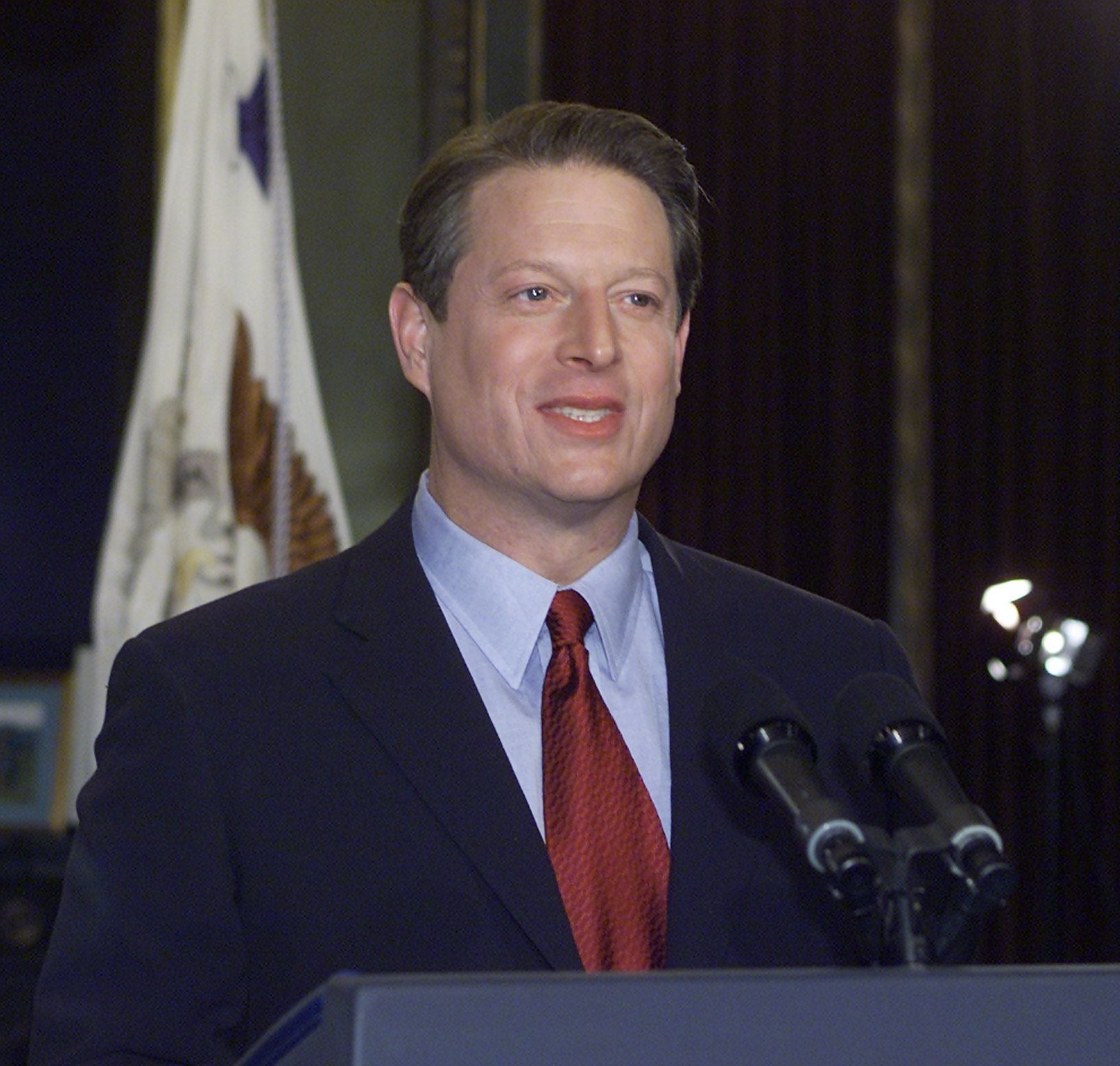 U.S. Vice President Al Gore poses for photographers following his concession speech 13 December, 2000 in his office in the Ol