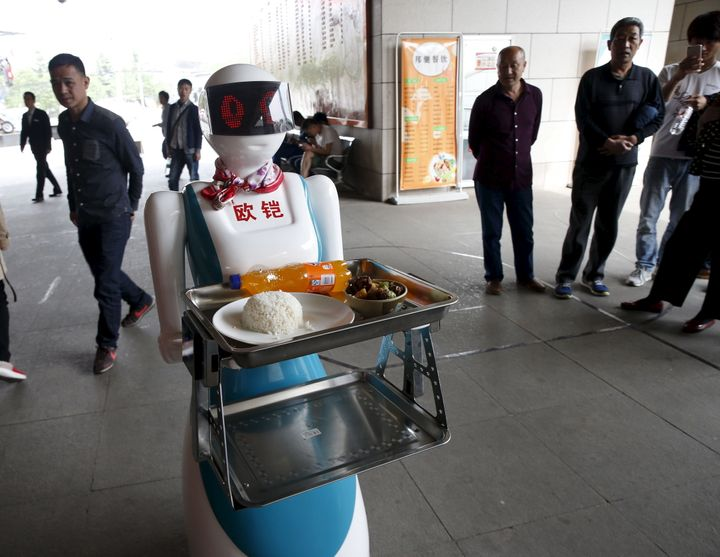 A robot works as a waitress for a restaurant in Xi'an, Shaanxi Province, China, April 20, 2016.