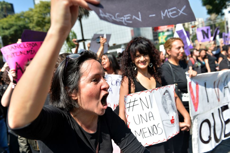 Women in Mexico City protest dressed in all black.