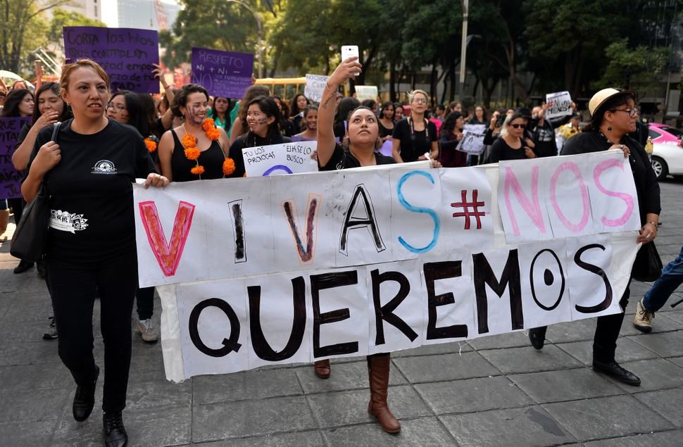 "Women march in Mexico City with a poster that says ""We want to live."""