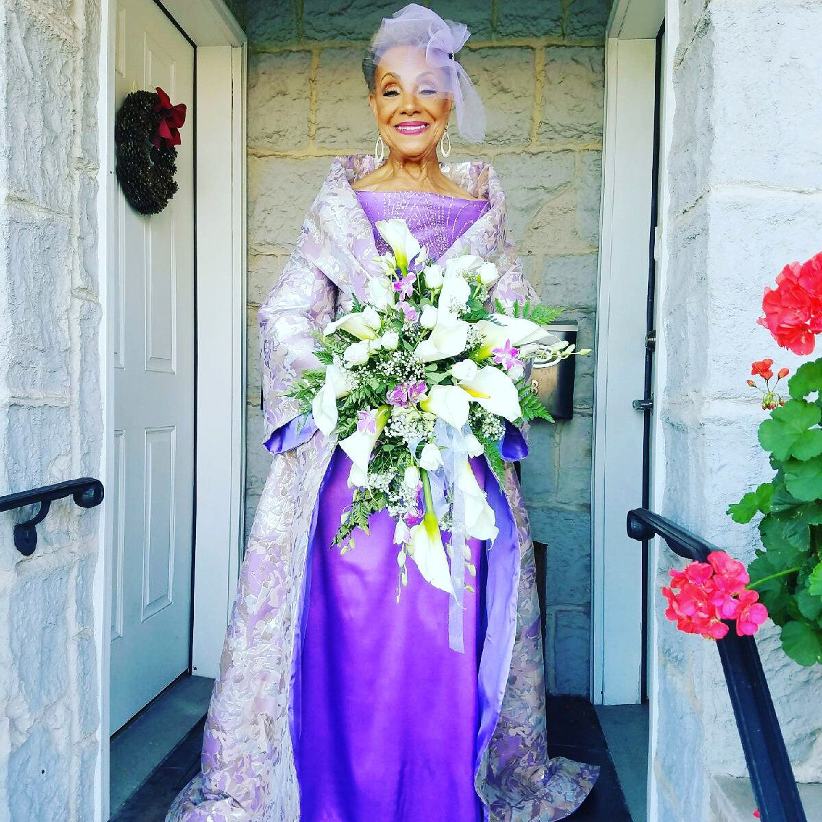 """Millie Taylor-Morrison, who was a model in the 1950s, designed the wedding dress herself. <a href=""""https://www.facebook.com/designermarcohall/"""" target=""""_blank"""">Designer Marco Hall</a> brought her vision to life, and<a href=""""http://www.tanikagreen.com/meet-the-stylist"""" target=""""_blank"""">Tanika Green</a>took care of the makeup."""