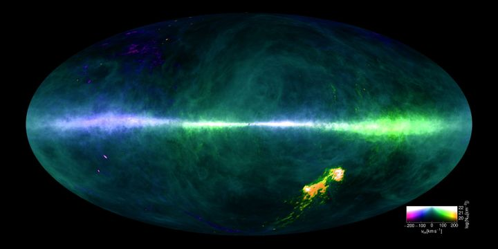 Colors reflect hydrogen gas at differing velocities.You can also see the plane of the Milky Way running across the imag