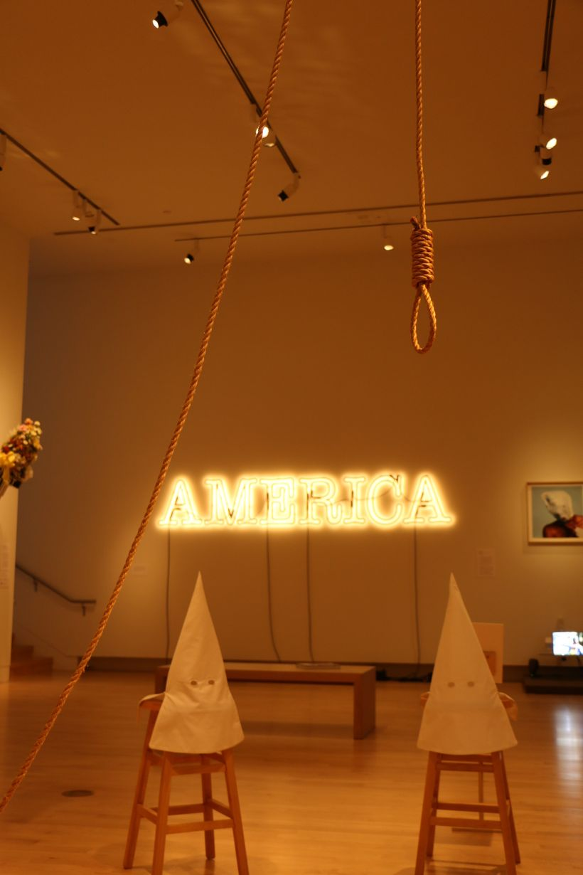 Duck, Duck, Noose by Gary Simmons and America by Glenn Ligon meld together in 30 Americans, on display at the Tacoma Art Muse