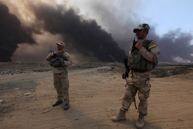 Members of the Iraqi army in the Iraqi town of Qayyarah during an operation to attack Islamic State militants...
