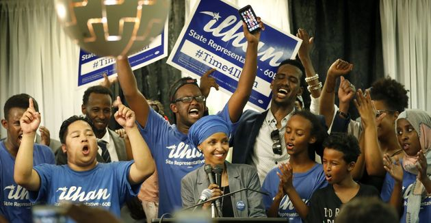 Ilhan Omar celebrates with supporters after her state's primary