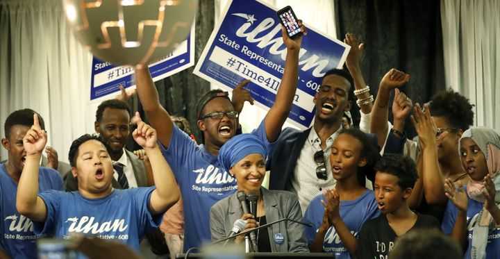 Ilhan Omar celebrates with supporters after her state's primary elections.