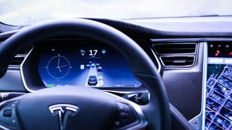 An instrument panel illustrates the road ahead using Autopilot technology just prior to the Tesla Motors Inc. 8.0 software update inside a Model S P90D vehicle in the Brooklyn borough of New York, U.S., on Monday, Sept. 19, 2016. The latest overhaul of the car's operating system, known as Tesla 8.0, biggest change is how Autopilot shifts towards a heavier reliance on its radar than its camera to guide the car through traffic. Photographer: Christopher Goodney/Bloomberg via Getty Images