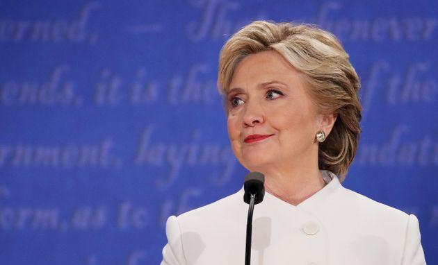 Democratic presidential nominee former Secretary of State Hillary Clinton listens to Republican presidential...