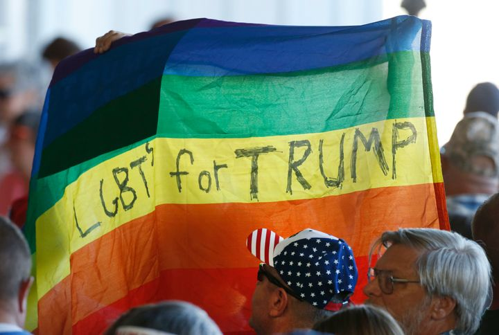 Supporters hold up a gay pride flag for Republican presidential nominee Donald Trump on Oct. 18, 2016, in Grand Junction