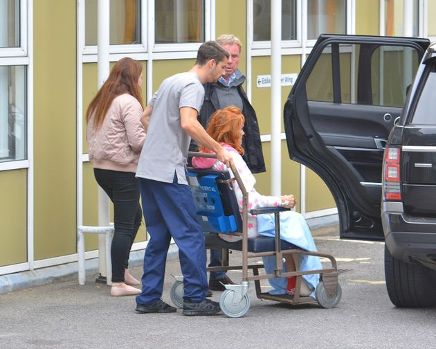 Sandra was pictured in a wheelchair beside her husband Harry on Thursday outside a hospital in Poole,