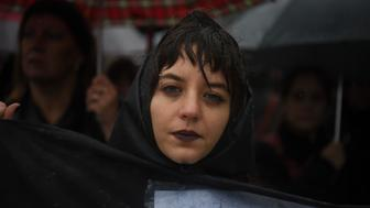Women take part in a march in Buenos Aires -where protesters held a one-hour 'women's strike'- on October 19, 2016, to protest against violence against women and in solidarity for the brutal killing of a 16-year-old girl in Mar del Plata  The killing, in which the high school student was allegedly raped and impaled on a spike by drug dealers, is just the latest incident of horrific gender violence in Argentina, which has seen more than a year of mass marches to protest brutality against women. / AFP / EITAN ABRAMOVICH        (Photo credit should read EITAN ABRAMOVICH/AFP/Getty Images)