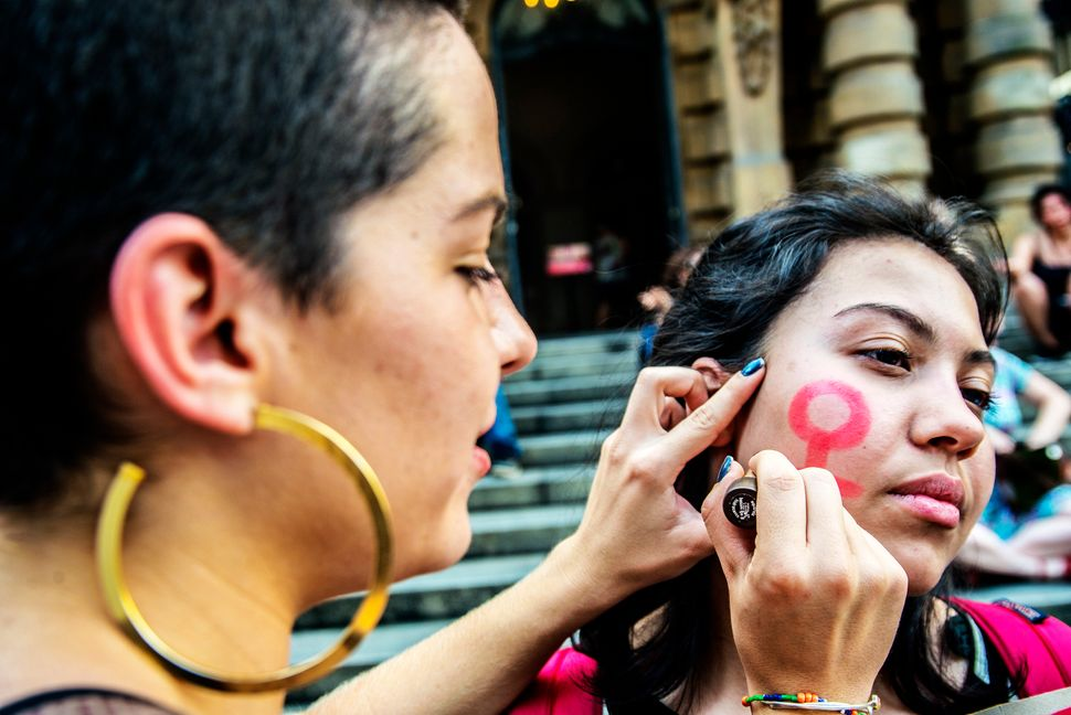 Women take part in a strike in Sao Paulo, Brazil, to protest against violence against women and in solidarity for the br