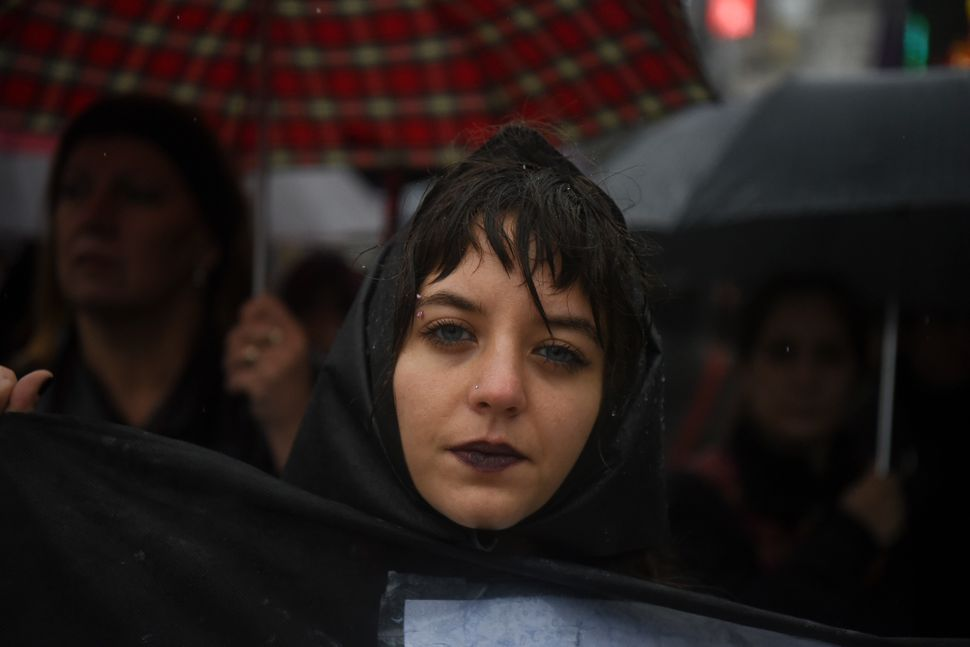 A woman protests in all black in Buenos Aires.