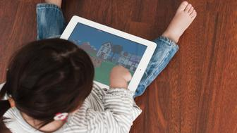 This is an image of a toddler learning ABC's on an iPad