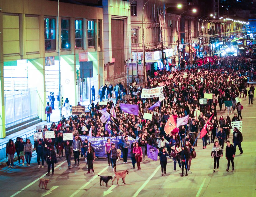 Women rally in the streets of Valparaiso, Chile against femicide in South America.