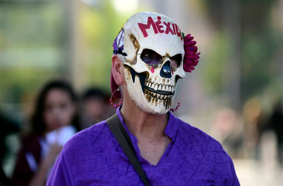 A woman takes part in protests against violence against women in Mexico City.