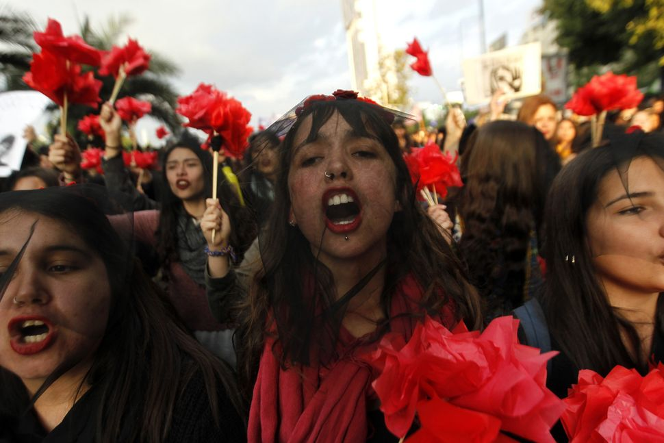 Women march in the streets of Santiago, Chile.