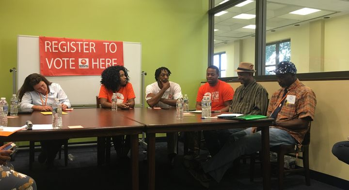 Tammie Hagen (far left) and Abdul-Rahman (far right) join a panel of former felons to talk to press about the restoration of