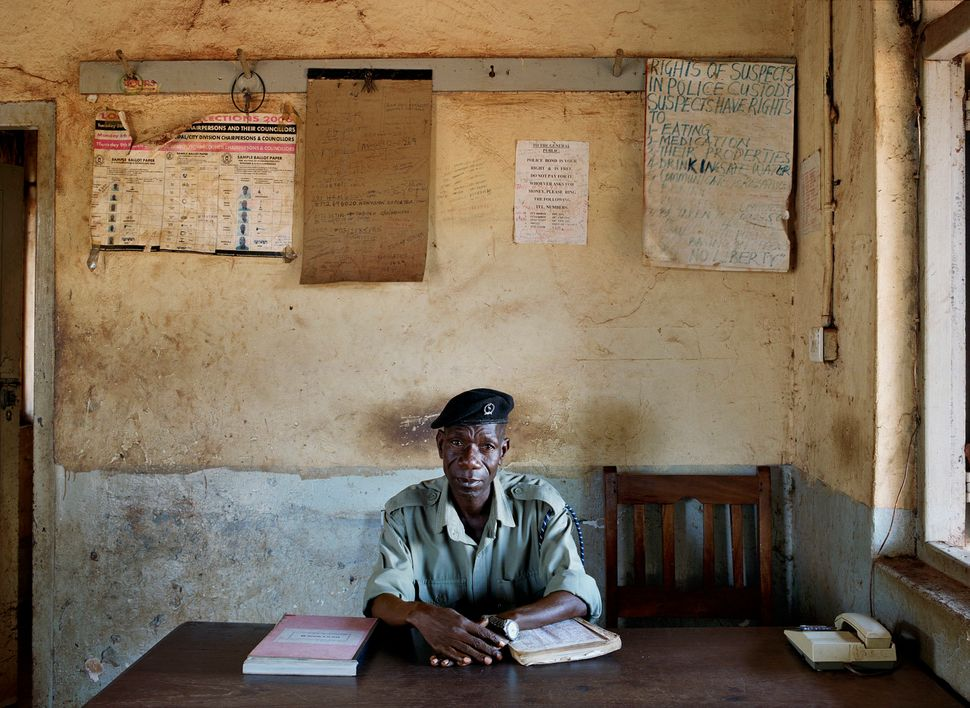 Kakira Police Station in Jinja. Constable # 11431, John Ndalira. (Uganda, May 2010.)