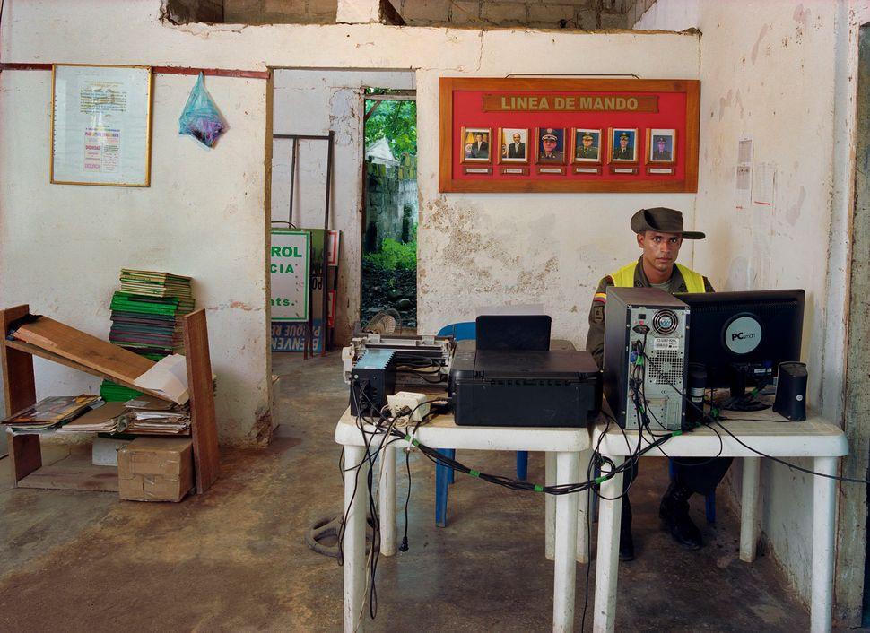 Countryside Police Substation in Retiro Nuevo, Patrolman Luis Ruiz Luna. (Colombia, Aug. 2011.)<i></i>