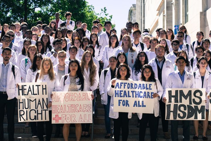Harvard Medical School students rally in support of Harvard dining services workers on September 12, 2016