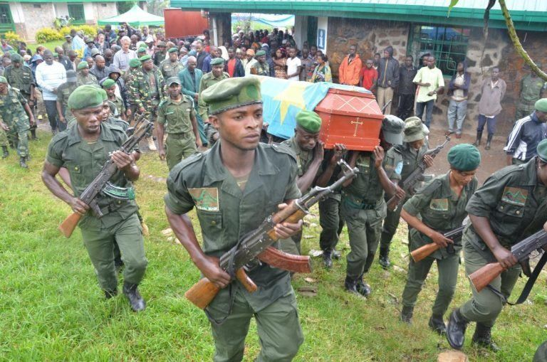 Wildlife rangershold a funeral for a guard killed in Kahuzi Biega National Park in the Congo.