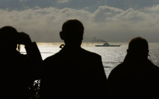 Observers regard the carrier from