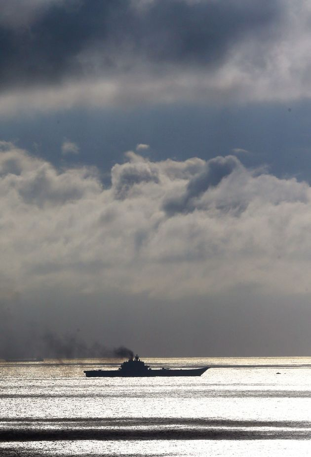 The Russian aircraft carrier Admiral Kuznetsov passes through the Strait of