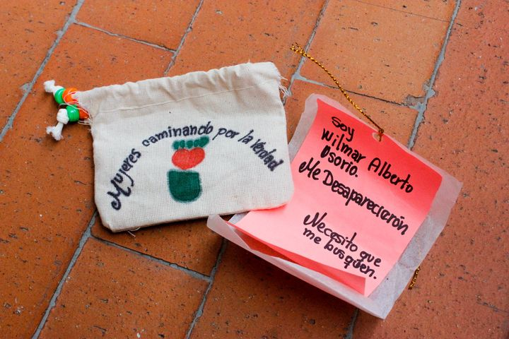 "Women Wallking for Truth member Luz Elena Galeano Laverde hand made pouches containing ""notes from the disappeared"" for distr"