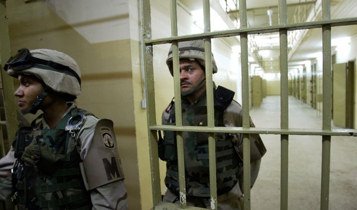 U.S. soldiers guard cells inside the prison of Abu Ghraib, outside Baghdad, Iraq, on May 5, 2004.