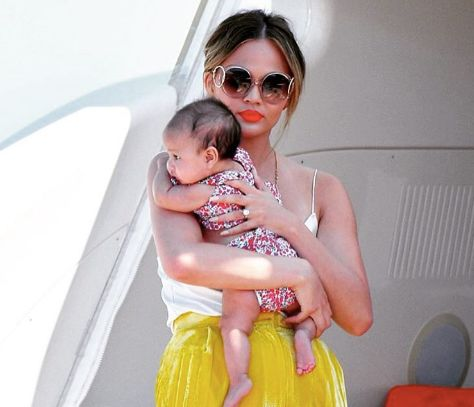 Chrissy Teigen Calls Out A Mum-Shamer For Telling Her How To Hold Baby