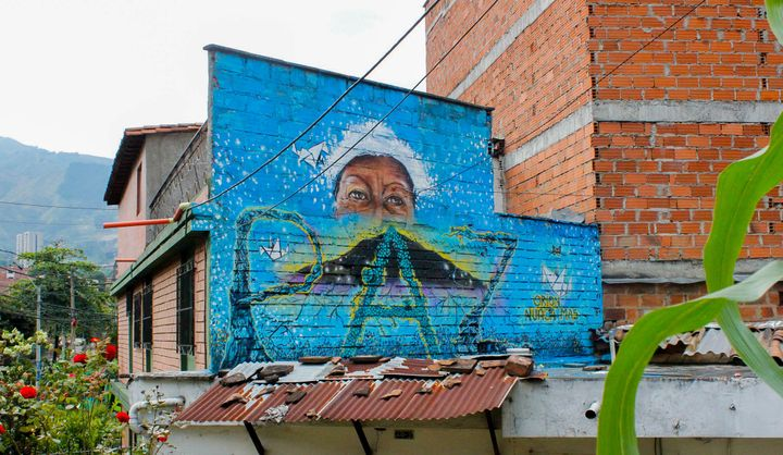 """Orion never again"" reads a mural commemorating 14 years since Operation Orion laid seige to the neighborhood of Comuna 13 in"